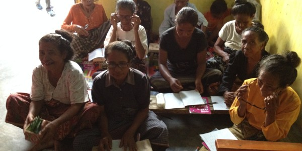 Indonesian women learning to read
